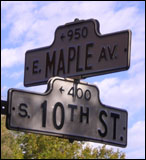 street signs at east maple avenue and 10th street