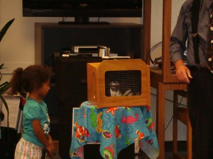 Mr. E and Silkiana Barela; Silkiana is assisting Mr. E with his bunny.