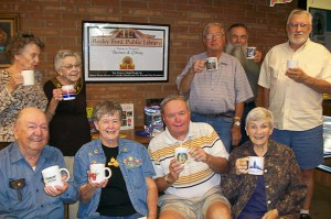Love Mug, October 4 thru 9, 2010; Is own by Sharayan Arellano, she has a variety of drinks from HOT DRINKS TO COLD DRINKS ALSO INCLUDES SMOOTHIES. Showing off there mugs are the Friends of the Library: Nancy Collier, Marge Jung, Ralph Merklinger, Ed Brown, Ron Gerboth, Dub Couch, Charlene Lindahl, Richard Power, Mary Lou Wolfson.