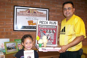 Pizza Plus Sept. 20-24, 2010; Pizza Plus offers prices THAT ARE RIGHT AND DELICIOUS PIZZA. Joe Medina and Granddaughter Priscilla Martinez take a look at The Book of Finger Foods by Hilaire Walden