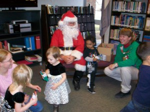 children, parents, Santa Claus and story teller at the library